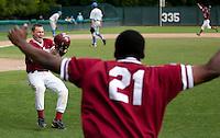 STANFORD, CA - April 23, 2011: Zach Jones of Stanford baseball celebrates scoring the winning run during Stanford's game against UCLA at Sunken Diamond. Stanford won 5-4.