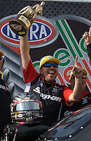 Apr. 28, 2013; Baytown, TX, USA: NHRA funny car driver Cruz Pedregon celebrates after winning the Spring Nationals at Royal Purple Raceway. Mandatory Credit: Mark J. Rebilas-