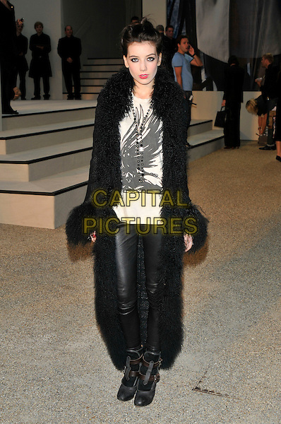 DAISY LOWE.The Burberry Closing Party for London Fashion Week held at Chelsea College for Art & Design, London, England..September 22nd 2009.LFW full length black fluffy fur coat leather leggings pants trousers white print top t-shirt .CAP/PL.©Phil Loftus/Capital Pictures.