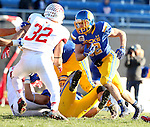 SIOUX FALLS, SD - NOVEMBER 7:  Kyle Paris #32 from South Dakota State University looks for running room past Alejandro Rivera #32 from Illinois State in the first half Saturday in the final game at Coughlin Alumni Stadium in Brookings. (Photo by Dave Eggen/Inertia)