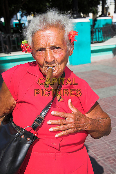 Old lady with a cigar in her mouth, Parque Cespedes, Santiago de Cuba, Cuba