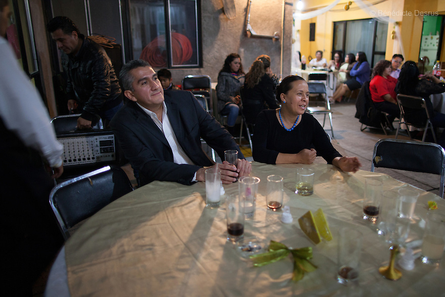 "Donovan sits with his wife at the wedding party of his sister-in-law in Iztapalapa, Mexico on October 31, 2015. Donovan Tavera, 43, is the director of ""Limpieza Forense México"", the country's first and so far the only government-accredited forensic cleaning company. Since 2000, Tavera, a self-taught forensic technician, and his family have offered services to clean up homicides, unattended death, suicides, the homes of compulsive hoarders and houses destroyed by fire or flooding. Despite rising violence that has left 70,000 people dead and 23,000 disappeared since 2006, Mexico has only one certified forensic cleaner. As a consequence, the biological hazards associated with crime scenes are going unchecked all around the country. Photo by Bénédicte Desrus"
