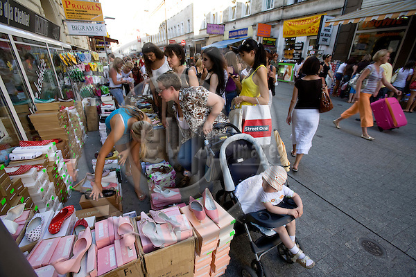 POZNAN - POLAND - 3 JUNE 2008 -- Women try shoes on at a sale on the street outside the shoeshop at the shopping street. Photo: Erik Luntang/EUP-IMAGES