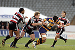 James Maher grabs Colin Bourke during the Air NZ Cup rugby game between Bay of Plenty & Counties Manukau played at Blue Chip Stadium, Mt Maunganui on 16th of September, 2006. Bay of Plenty won 38 - 11.