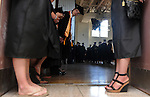 Bryan Schon of Enfield, bends his head out to see the faculty beginning to move as the students, who are lined up in the gym, waiting for the processional to begin prior to the Asnuntuck Community College graduation ceremony, Friday, June 3, 2011, in Enfield. (Jim Michaud/Journal Inquirer)
