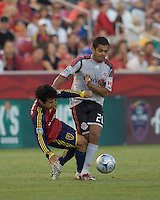 Real Salt Lake defender Tony Beltran (2) and Toronto FC midfielder Amado Guevara (20) battle for the ball. Salt Lake Real defeated Toronto FC, 3-0, at Rio Tinto Stadium on June 27, 2009.