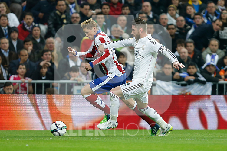 Real Madrid´s Sergio Ramos (R) and Atletico de Madrid´s Fernando Torres during Spanish King´s Cup match at Santiago Bernabeu stadium in Madrid, Spain. January 15, 2015. (ALTERPHOTOS/Victor Blanco)