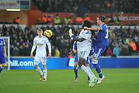 SWANSEA, WALES - JANUARY 17:   of  during the Barclays Premier League match between Swansea City and Chelsea at Liberty Stadium on January 17, 2015 in Swansea, Wales. Swansea's Bafetimbi Gomis battling for the ball with John Terry