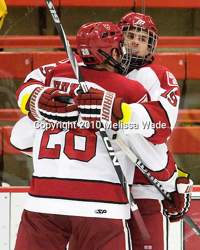Chris Huxley (Harvard - 28) and Alex Killorn (Harvard - 19) celebrate Killorn's goal which made it 2-1 Merrimack midway through the third period. - The visiting Merrimack College Warriors defeated the Harvard University Crimson 3-1 (EN) at Bright Hockey Center on Tuesday, November 30, 2010.