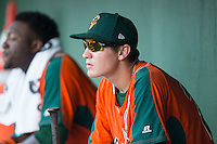 Ryan Aper (23) of the Greensboro Grasshoppers watches the action from the dugout during the game against the Kannapolis Intimidators at CMC-Northeast Stadium on June 11, 2015 in Kannapolis, North Carolina.  The Intimidators defeated the Grasshoppers 7-6.  (Brian Westerholt/Four Seam Images)