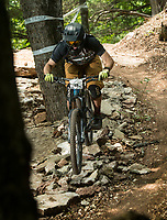 NWA Democrat-Gazette/BEN GOFF @NWABENGOFF<br /> Ryan Choate competes in a stage Saturday, Aug. 18, 2018, during the Eureka Springs round of the Arkansas Enduro Series at Lake Leatherwood City Park. The event continues Sunday with stages at the Passion Play trails and an urban downhill leg through downtown Eureka Springs. The fifth and final race of the Arkansas Enduro Series season takes place Sept. 22 at the Coler Mountain Bike Preserve in Bentonville. Enduro is a type of mountain bike race with multiple time trial stages that are mostly downhill and technical. The downhill stages are linked together by untimed transition stages or shuttle buses.