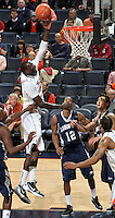 CHARLOTTESVILLE, VA- December 3: Assane Sene #5 of the Virginia Cavaliers shoots over Longwood Lancer defenders during the game on December 27, 2011 at the John Paul Jones Arena in Charlottesville, Virginia. Virginia defeated Longwood 86-53. (Photo by Andrew Shurtleff/Getty Images) *** Local Caption *** Assane Sene