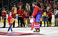 WASHINGTON, DC - APRIL 06: Washington Capitals left wing Alex Ovechkin (8) takes off his jersey to give to a young girl after the final game of the season as part of the Fan Appreciation Game after the New York Islanders vs. the Washington Capitals NHL game April 6, 2019 at Capital One Arena in Washington, D.C.. (Photo by Randy Litzinger/Icon Sportswire)