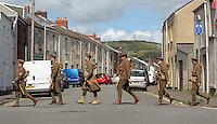 Men in World War I gear walking up Richardson Street, Swansea, south Wales UK. Friday 01 July 2016