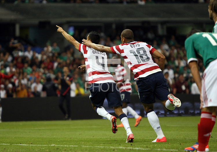MEXICO CITY, MEXICO - AUGUST 15, 2012:  Michael Orozco Fiscal (4) and Terrence Boyd (18) of the USA MNT peel away after Michael Orozco Fiscal (4) had scored the winning goal against Mexico during an international friendly match at Azteca Stadium, in Mexico City, Mexico on August 15. USA won 1-0.