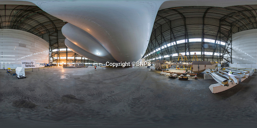 "BNPS.co.uk (01202 558833)<br /> Pic: PhilYeomans/BNPS<br /> <br /> 360 Pano.<br /> <br /> The historic hangar at Cardington Airfield near Bedford is once again filled with a massive Aiship after Hybrid Air Vehicles have inflated their revolutionary new lighter than air vehicle before its flight next year.<br /> <br /> Airlander, the world's largest aircraft, reached another milestone in its Flight programme with its first helium fill. On Saturday, 31 October at 10pm, it was floating for the first time at its Hangar in Cardington, Bedfordshire. <br /> <br /> The 92 metre-long Airlander was ""walked"" the entire length of the 248 metre Hangar to get to the front doors of the Hangar.  This involved 4 fork lift trucks, one at each corner of the Airlander, each carrying a 2-tonne block of cement with a restraining rope attached moving in unison."