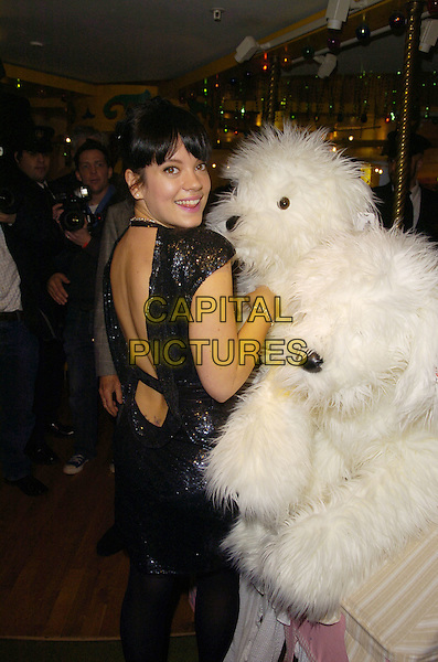 LILY ALLEN.opening The Harrods Winter Sale..Knightsbridge, London, England..28th December 2007.half length black dress with stuffed soft toy dog .CAP/CAN.©Can Nguyen/Capital Pictures
