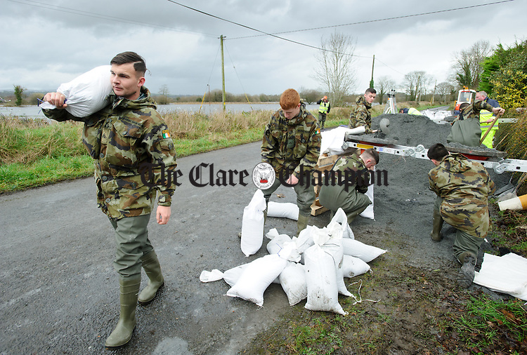 Army personnel help with filling and delivering sand bags in the Springfield, Clonlara area as residents prepare for flooding due to high water levels in Parteen Weir. Photograph by John Kelly.