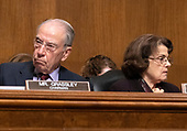 United States Senator Chuck Grassley (Republican of Iowa), chairman, left, and US Senator Dianne Feinstein (Democrat of California), ranking member, listen to the opening statements as the US Senate Committee on the Judiciary meets to vote on the nomination of Judge Brett Kavanaugh to be Associate Justice of the US Supreme Court to replace the retiring Justice Anthony Kennedy on Capitol Hill in Washington, DC on Friday, September 28, 2018.  If the committee votes in favor of Judge Kavanaugh then it goes to the full US Senate for a final vote.<br /> Credit: Ron Sachs / CNP<br /> (RESTRICTION: NO New York or New Jersey Newspapers or newspapers within a 75 mile radius of New York City)