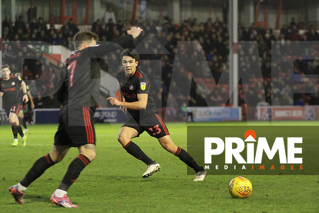 Luke O'Nien (Sunderland AFC) passes to Chris Maguire (Sunderland AFC) during the Sky Bet League 1 match between Walsall and Sunderland at the Banks's Stadium, Walsall, England on 24 November 2018. Photo by James  Gill / PRiME Media Images.