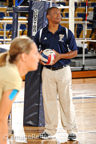11 September 2011:  FIU Assistant Coach Trevor Theroule puts his players through drills prior to the match.  The FIU Golden Panthers defeated the Florida A&M University Rattlers, 3-0 (25-10, 25-23, 26-24), at U.S Century Bank Arena in Miami, Florida.