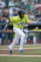 Right fielder Wagner Lagrange (23) of the Columbia Fireflies runs toward first base in a game against the Charleston RiverDogs on Saturday, April 6, 2019, at Segra Park in Columbia, South Carolina. Columbia won, 3-2. (Tom Priddy/Four Seam Images)