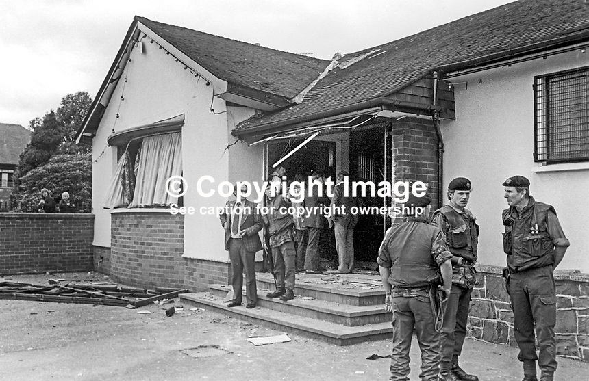 Military and police at the scene of the 29th July 1976 explosion at the White Fort Inn, Andersonsontown, Belfast, N Ireland. There were two immediate fatalities and a third man died from his injuries on 8th September 1976. Approximately 60 men in the bar at the time of who 16 were injured. The attack was attributed to the UVF, Ulster Volunteer Force. 197607290337b<br /> <br /> Copyright Image from Victor Patterson, 54 Dorchester Park, Belfast, UK, BT9 6RJ<br /> <br /> Tel: +44 28 9066 1296<br /> Mob: +44 7802 353836<br /> Voicemail +44 20 8816 7153<br /> Email: victorpatterson@me.com<br /> Email: victorpatterson@gmail.com<br /> <br /> IMPORTANT: My Terms and Conditions of Business are at www.victorpatterson.com