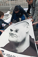 Moscow, Russia, 06/05/2013..Organisers prepare a poster of opposition leader Sergei Udaltsov, currently under house arrest, as some 20,000 demonstrators protested against Russian President Vladimir Putin and demanded the release of political prisoners. The demonstration marked the first anniversary of a protest that descended into violence between protesters and police  and resulted in over 600 arrests.