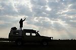 African Lion (Panthera leo) biologist, Milan Vinks, tracking female using telemetry, Busanga Plains, Kafue National Park, Zambia