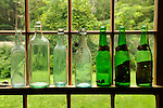 Antique Shop. Collectable bottles in window..