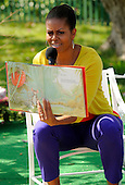"First lady Michelle Obama reads from the children's book ""The Little Mouse, the Red Ripe Strawberrry and the Hungry Bear"" during the White House Easter Egg Roll on the South Lawn of the White House in Washington, D.C. on April 9, 2012. .Credit: Mike Theiler / Pool via CNP"