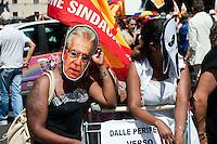 Roma 22 Giugno 2012.Manifestazione  dei sindacati di base contro le politiche economiche e sociali del Governo Monti..Manifestante con la maschera di Mario Monti