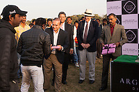Jewelry designer Nirav Modi presents a gift to an umpire of the Argyle Pink Diamond Cup, organised as part of the 2013 Oz Fest in the Rajasthan Polo Club grounds in Jaipur, Rajasthan, India on 10th January 2013. Photo by Suzanne Lee