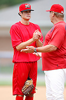 July 3, 2009:  Pitcher Joe Kelly of the Batavia Muckdogs talks with coach Dyer Miler before a simulated game at Dwyer Stadium in Batavia, NY.  The Muckdogs are the NY-Penn League Short-Season Class-A affiliate of the St. Louis Cardinals.  Photo by:  Mike Janes/Four Seam Images