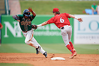 Lakewood BlueClaws shortstop Nick Maton (6) tags Jhonny Santos (21) out after over sliding on a stolen base attempt during a game against the Greensboro Grasshoppers on June 10, 2018 at First National Bank Field in Greensboro, North Carolina.  Lakewood defeated Greensboro 2-0.  (Mike Janes/Four Seam Images)