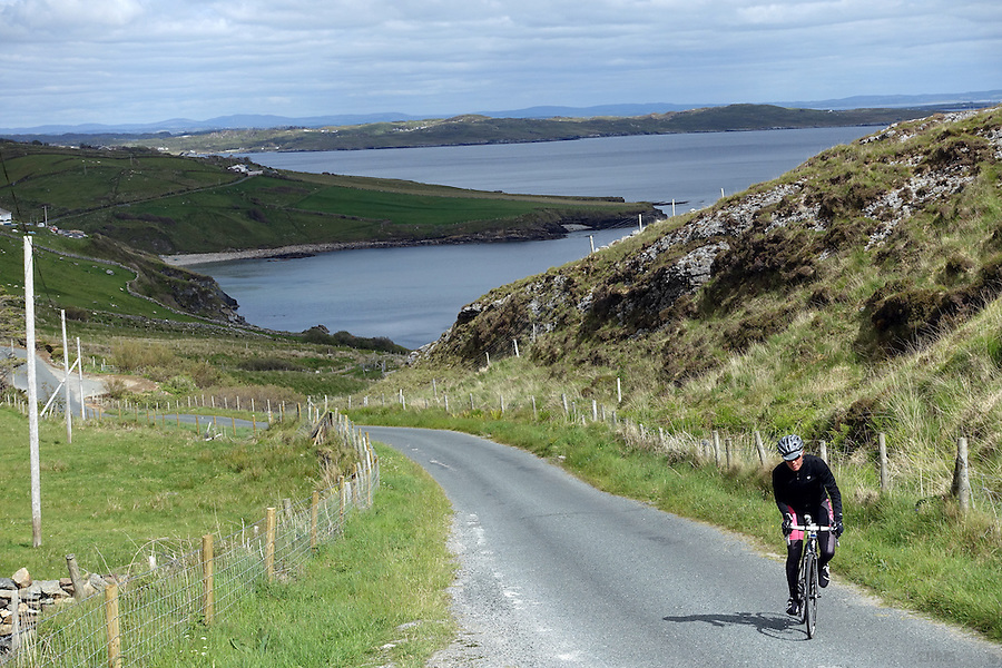 Cycling along County Donegal's Coast Road, Sli an Atlantaigh Fhiáin, Ireland.