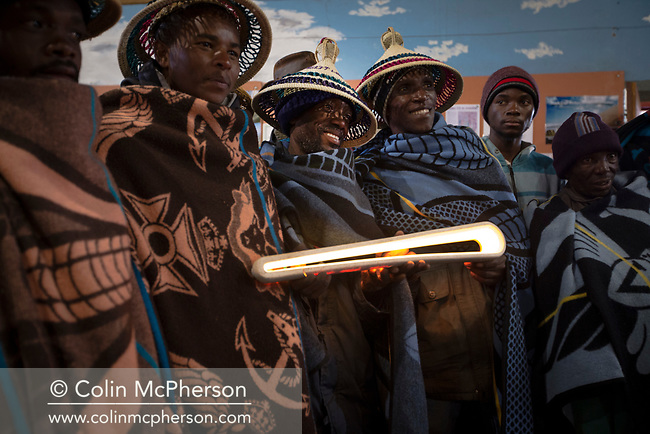 The Queen's Baton took part in various events in Lesotho on 12 May, 2017, including a relay from the centre of the capital Maseru which was led off by His Majesty King Letsie III. This Queen's Baton Relay will visit all 70 nations and territories of the Commonwealth, over 388 days and cover 230,000km. It will be the longest Relay in Commonwealth Games history, finishing at the Opening Ceremony on the Gold Coast on 4th April 2018. Photograph shows a group horsemen in traditional dress with the Baton as it travelled from Maseru to Malea-lea Lodge.