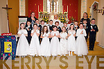 Pictured at their communion in the Holy Trinity Church, Templeglantine on Sunday were the students of Templeglantine National School with their principal AnnMarie Leonard (left), priest Fr. Hurley and class teacher Brid O'Rourke (right).