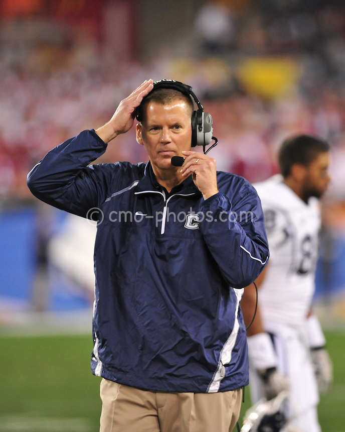 Jan 1, 2011; Glendale, AZ, USA; Connecticut Huskies head coach Randy Edsall walks on the sidelines in the 1st quarter of the 2011 Fiesta Bowl against the Oklahoma Sooners at University of Phoenix Stadium.  The Sooners won the game 48-20.
