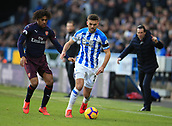9th February 2019, The John Smith's Stadium, Huddersfield, England; EPL Premier League football, Huddersfield versus Arsenal; Tommy Smith of Huddersfield Town controls the ball under pressure from Alex Iwobi of Arsenal