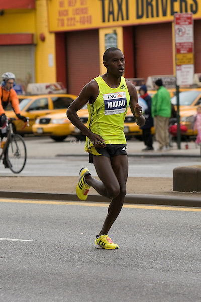 Patrick Makau leads the pack of Men's Elite runners as they approach Mile 7 in the ING New York City Marathon.