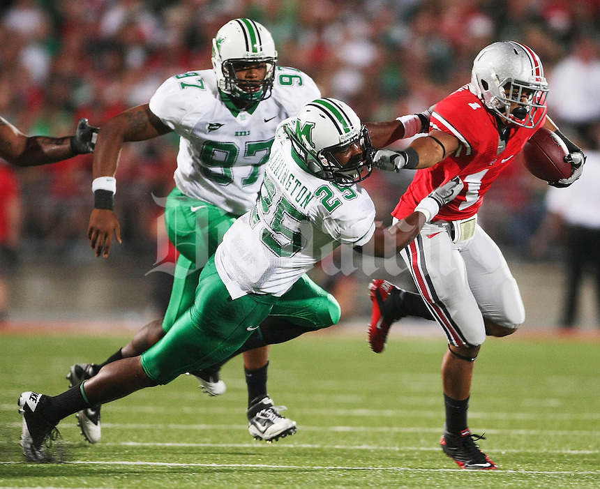 Ohio State Daniel Herron (1) deflects Marshall's Devin Arrinton (25) during the second half of the NCAA football game at Ohio Stadium on September 2, 2010. (Photo by Neal C. Lauron)