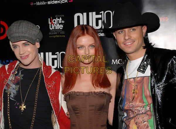 "RICHIE RICH, LYDIA HEARST & TREVOR RAINS.""Out""Magazine honors 100 most influential people in gay culture during ""Out 100 Awards"" at Capitale, New York, NY, USA, 10 November 2006..half length brown strapless dress hat cap.Ref: ADM/PH.www.capitalpictures.com.sales@capitalpictures.com.©Paul Hawthorne/AdMedia/Capital Pictures. *** Local Caption ***"