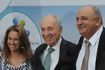 From right to left:<br /> <br /> Controller of Delek Group Yitzhak Tshuva, Israel's President Shimon Peres, owner of the Arison Group Shari Arison, at an opening event of a new desalination facility in Hadera, Israel, on Sunday, May 16, 2010.<br /> <br /> Photographer: Ahikam Seri