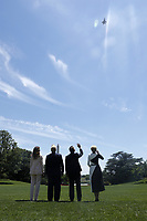 (L-R) US First Lady Melania Trump, US President Donald J. Trump, Polish President Andrzej Duda and Polish First Lady Agata Kornhauser-Duda watch a flyover by US Lockheed Martin F35 planes from the South Lawn after particvipating in a signing ceremony in the Diplomatic Reception Room of the White House in Washington, DC, USA, 12 June 2019. President Trump and President Duda signed an agreement to increase military to military cooperation including the purchase of F-35 fighter jets by Poland and an increased US troop presence in Poland. <br /> Credit: Shawn Thew / Pool via CNP/AdMedia