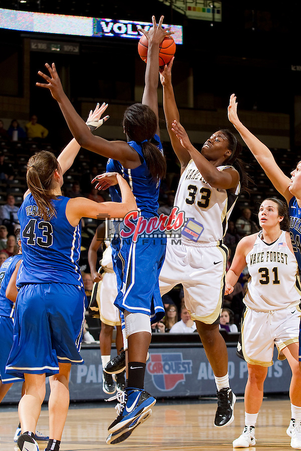 Asia Williams #33 of the Wake Forest Demon Deacons has her shot blocked by Elizabeth Williams #1 of the Duke Blue Devils at the LJVM Coliseum on January 6, 2012 in Winston-Salem, North Carolina.  The Blue Devils defeated the Demon Deacons 76-58.    (Brian Westerholt / Sports On Film)