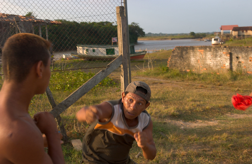 A fisticuff erupts on a soccer field in the town of Cachoeira do Arari (acute accent on final i) on the island of Marajo (acute accent on the final o). The size of Switzerland, Marajo is a vast expanse of wilderness and cattle and water buffalo ranches, offering a close look at rural life in equatorial Brazil. (Kevin Moloney for the New York Times)