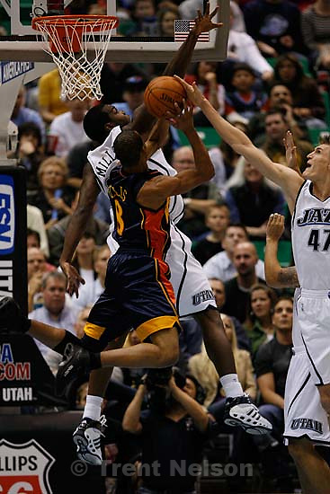 Salt Lake City - Utah Jazz forward Paul Millsap (24) and Utah Jazz forward Andrei Kirilenko (47) block Golden State Warriors guard Monta Ellis (8). Utah Jazz vs. Golden State Warriors, NBA basketball Saturday night at EnergySolutions Arena.