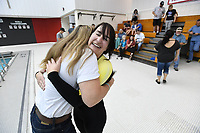 NWA Democrat-Gazette/J.T. WAMPLER Lindsay Scott of Farmington hugs her roommate Lisa Jansen (left) Sunday Nov. 5, 2017 after setting a Guinness World Record for the fastest time to put on and take off a wetsuit in Fayetteville. Scott performed the feat in front of expert witnesses in fields including law enforcement, legal, and swimming and an official time was recorded. She is submitting the record at 43.13 seconds.