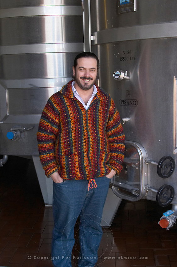 Gustavo Pisano one of the brothers Pisano in the modern wine cellar in front of a stainless steel tank. Bodega Pisano Winery, Progreso, Uruguay, South America